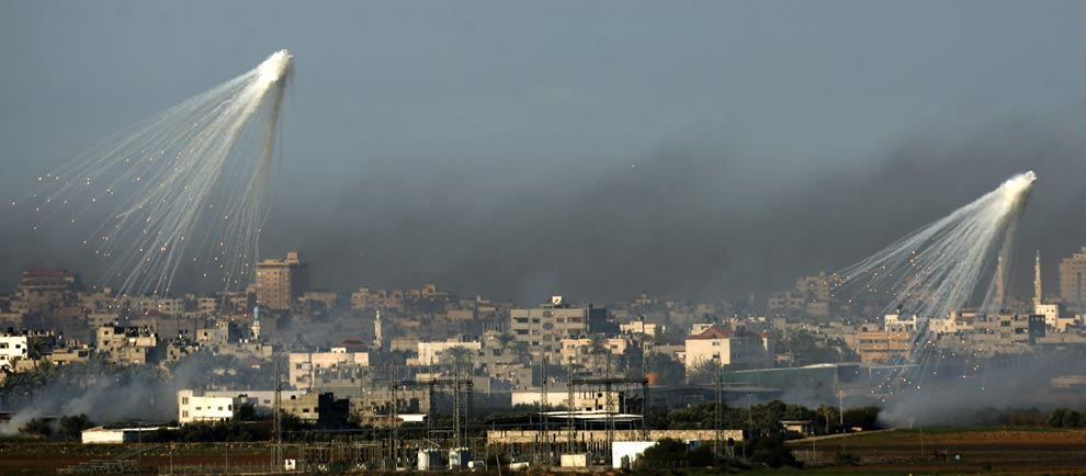 Artillery shells explode above Gaza City on January 4, 2008, as seen from the Israeli side of the Israel-Gaza border. (PATRICK BAZ/AFP/Getty Images)
