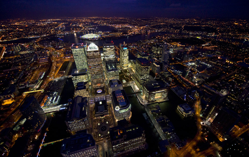 1,200 ft over West India Docks and the Towers around Canary Wharf on the Isle of Dogs. In the far background you can just make out the lights of City Airport in the former Royal Albert Docks.