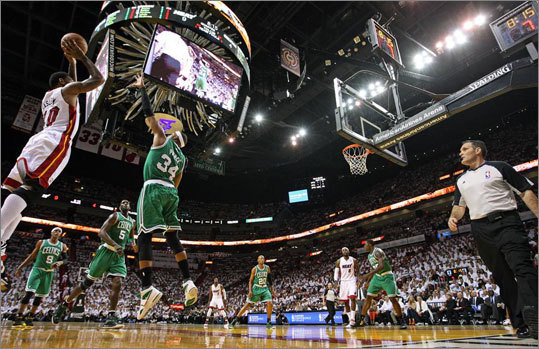 Miami's Udonis Haslem fired up a first quarter shot as Paul Pierce defended.