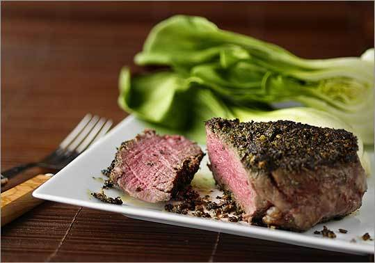Crumbled green tea leaves and minced lemon grass are rubbed over a tender cut of beef before the meat is seared on a stove top.