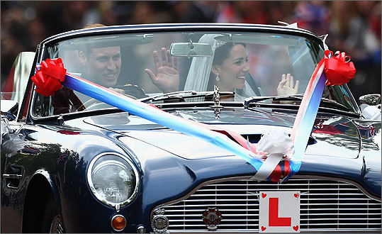 William and Catherine drove away from Buckingham Palace in an Aston Martin convertible.