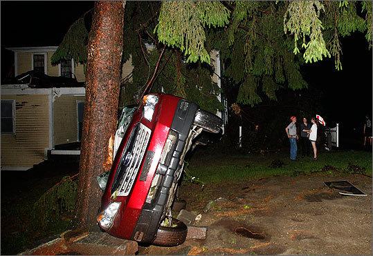 Car smashed against tree