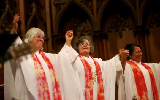 From left, Judy Lee of Florida, Gloria Carpeneto of Maryland, and Gabriella Velardi Ward of New York, during the ceremony in which the Roman Catholic Womenpriests organization said they were ordained as priests.