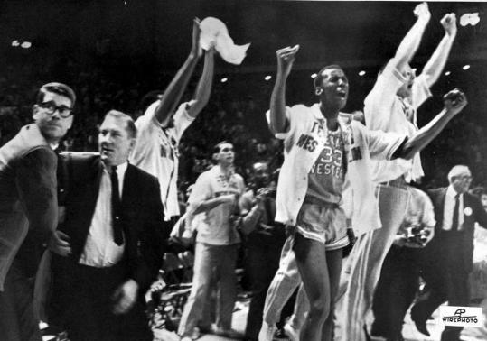 cfcbce857c4 Texas Western head coach Don Haskins (second from left) and his players  celebrated after