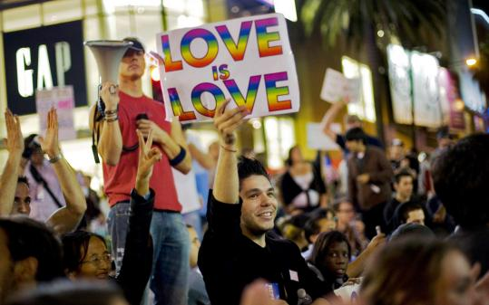 Protesters marched into the early morning in Los Angeles yesterday, expressing their anger against the passage of Proposition 8.
