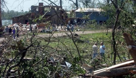 Residents of Mississippi's Warren County sifted through what was   left of their homes after a tornado ripped through their street.