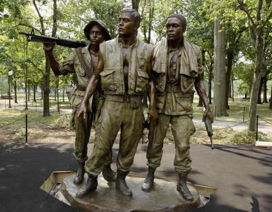 The bronze statue at the  Vietnam Veterans Memorial in Washington had turned greenish-blue over  the years.