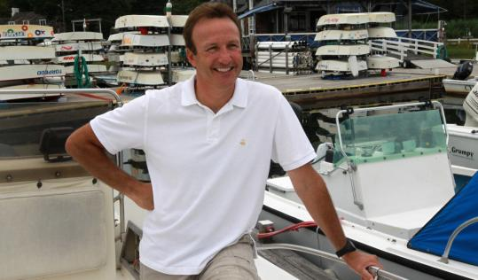 Anthony Everett, on his boat at Cohasset Yacht Club, has taken to the South