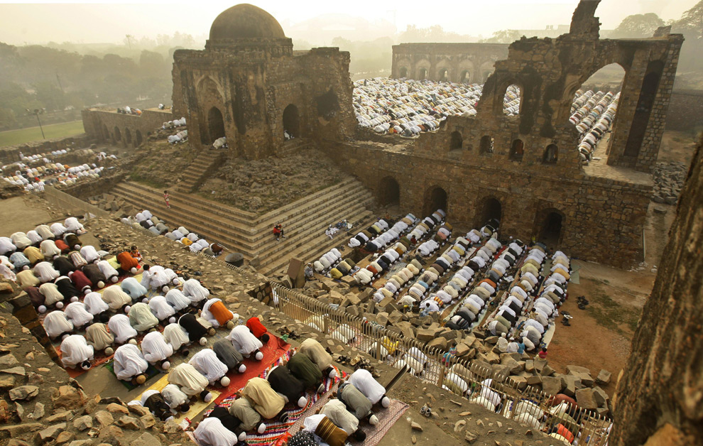 In New Delhi, India, Muslims offer Eid al-Adha prayers at the Ferozshah Kotla Mosque on Tuesday, Dec. 9, 2008. (AP Photo/Gurinder Osan) See the rest of the Eid pictures: Here